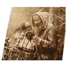 Real French Photo Postcard of Santa and his sack of Toys