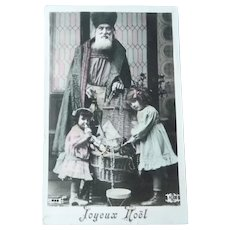 Vintage French Real Photo Postcard of Father Christmas and Children