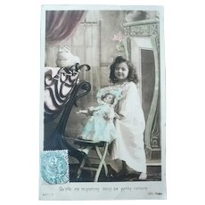 Vintage Real Photo French Postcard of a girl anf her doll