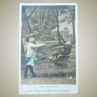 Vintage Real Photo Postcard of Tinted Child Pushing His Dog