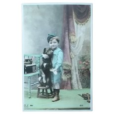 Vintage Real Photo Postcard of a Boyscout and his Dog