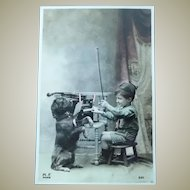 Vintage Real Photo Postcard of a Boy scout and his dancing dog