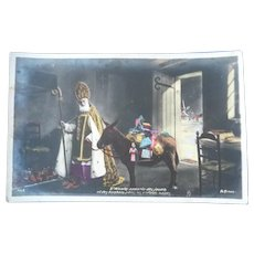 Vintage Real Photo French Postcard of Father Christmas and his Donkey