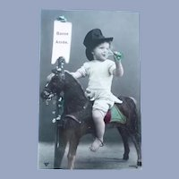 Vintage New Years French Photo Postcard of a Child Riding His Horse