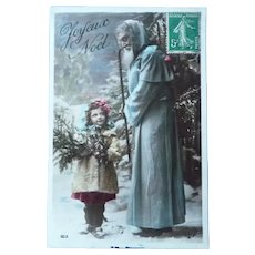 Vintage Real Photo Postcard of Blue Clocked Santa and Child