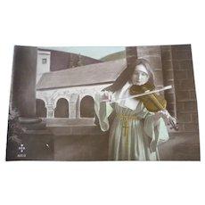 Vintage photo postcard of a musical nun