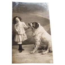 Vintage Real Photo Postcard of an Edwardian girl and her Dog