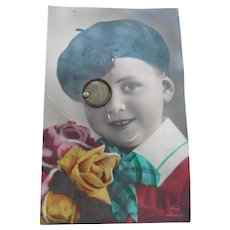 Vintage French Real Photo Sqeak Toy postcard of Boy wearing a monicle Eyeglass