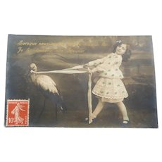 Vintage Real Photo French Postcard of Girl and Stork