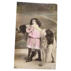 1906 Vintage Real Photo Postcard of an Edwardian Girl Loving her Dog
