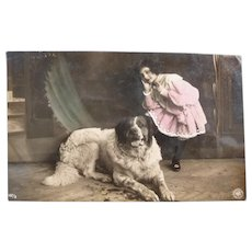 Vintage Real Photo French Postcard of an Edwardian girl and her dog