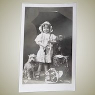 Vintage French Photo Postcard of Girl and her pet dogs