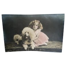 Vintage Real Photo French Postcard of a Edwardian Girl and her Poodle