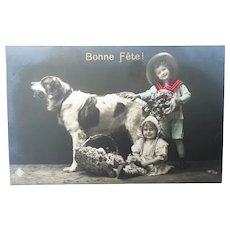 Vintage Real Photo French Postcard of Children and their pet Dog