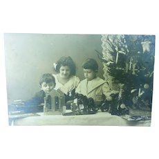 Vintage Christmas Postcard of Children and their toys