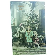 Vintage Real Photo French postcard of Children at Christmas