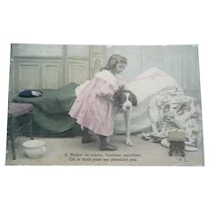 French Real Photo Postcard of a Girl tending her sick Dog