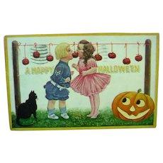 Vintage Halloween Postcard of cute Children.