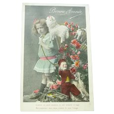vintage French Real Photo Postcard of an Edwardian Girl and her Toys