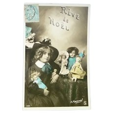 Vintage French Real Photo Postcard of A child and their many Dolls