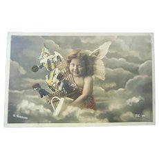 Vintage Real Photo Postcard of Angel and Toys