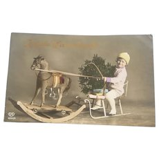 Vintage Real Photo German Christmas Postcard of Boy and Toy Horse