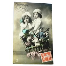 Vintage French Real Photo Postcard of Two Children in a Hot Air Balloon