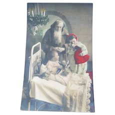 Vintage Real Photo French Postcard of Santa and Edwardian Children