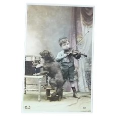 Vintage Real Photo French Postcard of dog playing the Toy Piano