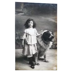 Vintage 1905 Real Photo French Postcard of a girl and her Dog