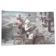 Vintage 1911 Real Photo Postcard of Children riding car