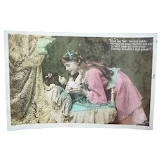 Vintage 1908 Real Photo French postcard of a Girl Putting her doll to Sleep