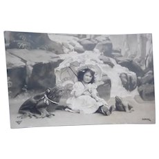 Vintage Real Photo French Postcard of Girl Sunbathing with her Frogs.