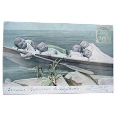Vintage French Real Photo Postcard of Babies on a boat