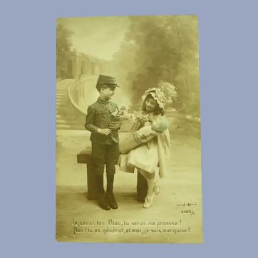 Vintage Edwardian Real Photo French Postcard of Boy Soldier and Girl with Doll