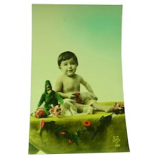 Vintage Real Photo French Postcard of Surreal Baby and Toy