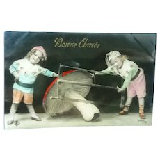Vintage Real Photo French New Years Postcard of Children Sawing a Mushroom