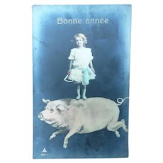 Vintage Surreal Real Photo French Postcard of girl and her Pig