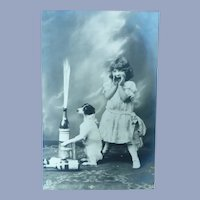 Vintage French Real Photo Postcard of Surprised girl and her Dog Creating Mischief