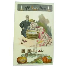 Vintage Jolly Halloween 1907 Postcard of Lady Bobbing for Apples