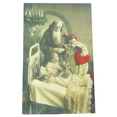 Vintage French Real Photo Postcard of Santa Visiting Children at Night