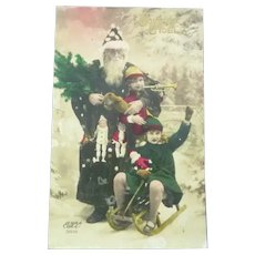 Vintage Real Photo French Postcard of Pere Noel and Children with their New Toys