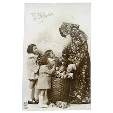 Vintage French Photo Postcard of Santa being Admired by Children