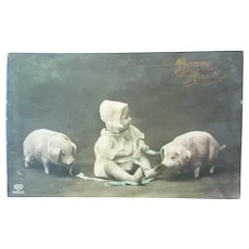 Vintage Real Photo French Postcard of Baby and her Pigs