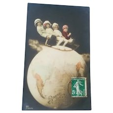 Vintage Real Photo French Postcard of Children on Slide on Top of the World