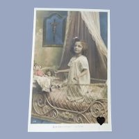 Vintage Real Photo French Postcard of Little Girl Praying over her Dolls