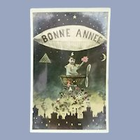 Vintage French Real Photo New Years Postcard of Child Dropping gifts over a village