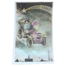 Vintage Real Photo French New Year's Surreal Postcard of Child in Vintage Auto