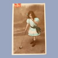 Vintage Real Photo French Postcard of Girl Playing with Toy