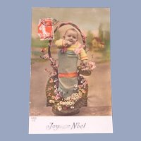 Vintage Christmas Real Photo French Postcard of Baby in a Basket